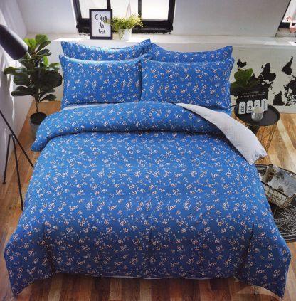 Lenjerie de pat alba albastra cu flori